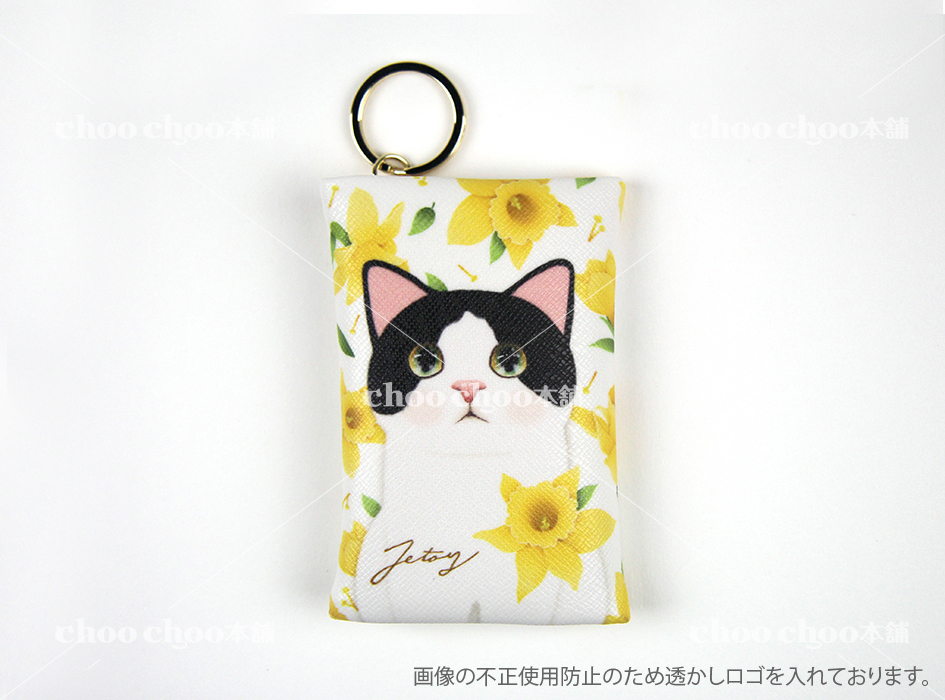 華やかなイエローのお花に囲まれた<br>愛らしい白黒ネコの<br>カードケースチャーム♪